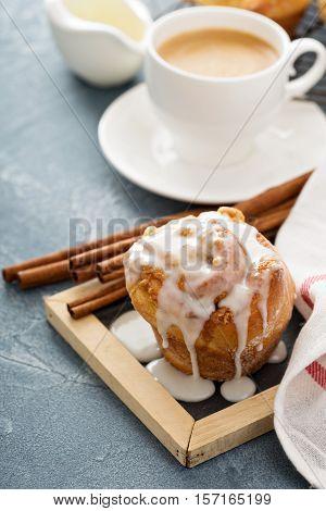 Cinnamon bun with cream cheese glaze for breakfast
