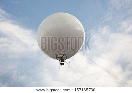 Aerial photography using a captive balloon over a city