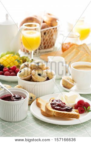 Fresh and bright continental breakfast table with coffee, toast and jam