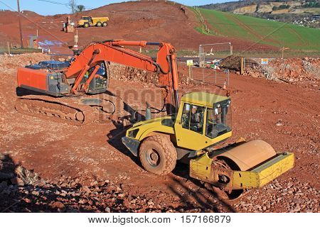 Roller and Digger on a construction site