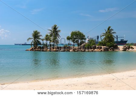 Singapore travel - view of beach in Sentosa island, Singapore. Singapore is a global commerce, finance and transport hub. Singapore destination.