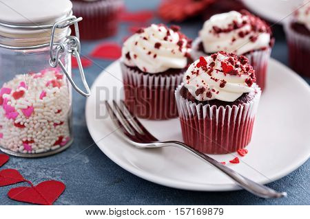 Red velvet cupcakes for Valentines Day in bright colorful setting