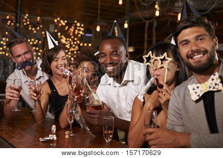 Friends celebrating New Year Eve at a party in a bar