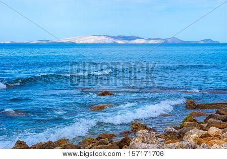The gentle waves at the rocky shore of Herklion Crete Greece.