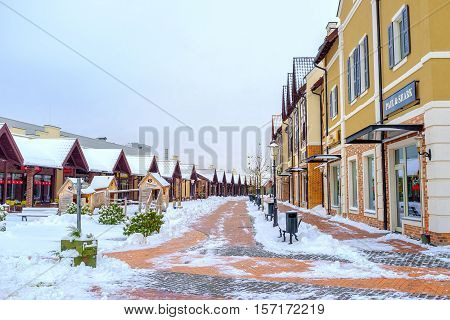 KIEV UKRAINE - NOVEMBER 11 2016: The winter view of the Dutch shopping city with snowy roofs and alleys on November 11 in Kiev.