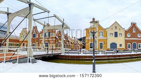 KIEV UKRAINE - NOVEMBER 11 2016: Panorama of the Dutch Revival style shopping city with the drawbridge over the narrow canal on November 11 in Kiev.