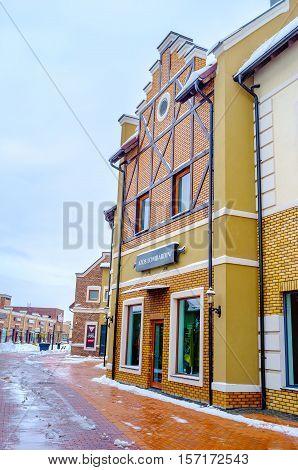 KIEV UKRAINE - NOVEMBER 11 2016: The Dutch style stepped gable house in the modern shopping city on November 11 in Kiev.