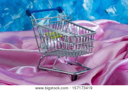 a shopping cart shopping cart to decorate the table on fabric background