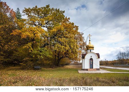 Chapel on the edge of autumnal forest