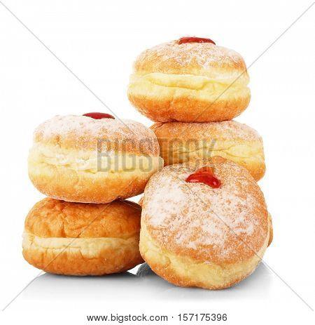 Tasty donuts with jam on white background. Hanukkah celebration concept