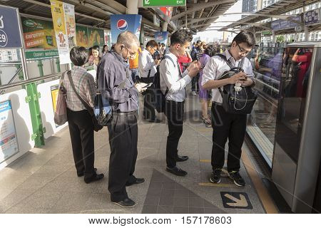 BANGKOKTHAILAND - AUG 26 : Unidentified people wait for train upcoming on platform at BTS Onnut station on august 26 2016 Thailand.