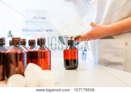 Creating and refilling or cough syrup at a pharmacy