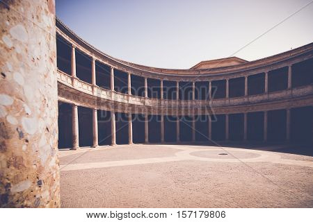 The columned courtyard at the Palace of Charles V (Palacio de Carlos V) site of the Museum of the Alhambra in Granada Spain. Andalusia