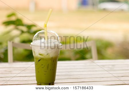 green tea frappe/green tea smoothie on wooden table