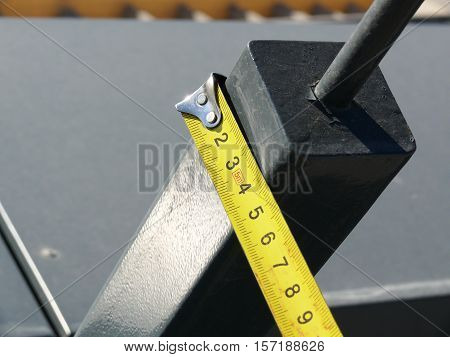 measurement of the dimensions of metal structures on the roof.