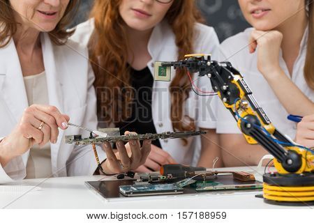 Women Working On A Mainboard
