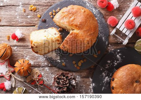 Christmas Panettone Bread With Dried Fruit And Festive Decoration Close-up. Horizontal Top View