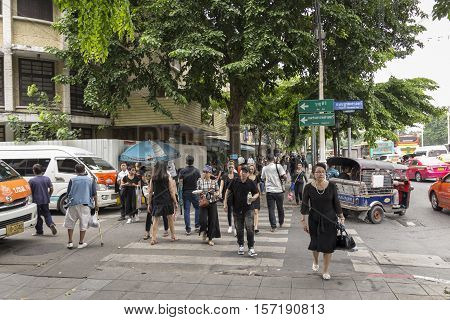 BANGKOK THAILAND - OCT 19 : scene of people at Ratchadamnoen Klang Road near Sanam Luang while the funeral of king Bhumibol Adulyadej in Grand Palace on october 19 2016