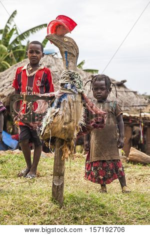 OMO VALLEY. ETHIOPIA - JANUARY 2 2014: Unidentified local children in local gallery of sculptures made from recycled materials.