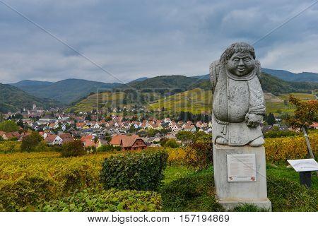 Andlau, Alsace Village, Vineyard, Statue Of Monk Carrying Wine Barrel