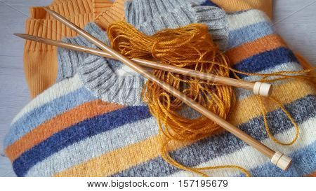 Yarn for knitting and sweaters in ocher and terracotta colors