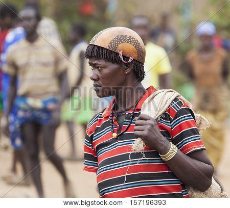 Ari Woman In Calabash Hat/helmet At Village Market. Bonata. Omo Valley. Ethiopia.
