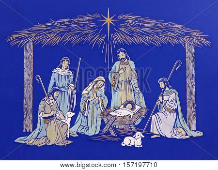 Depicting the birth of Jesus.  Manger scene includes illustration of Jesus, Mary, Joseph, Shepherds, lambs, all gathered around the baby in the trough.  Star of Bethlehem shines above the manger.