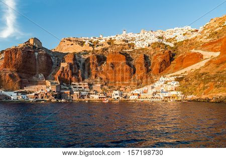 Greece Santorini the Oia village and its small seaport seen from the Caldera sea area at nightfall