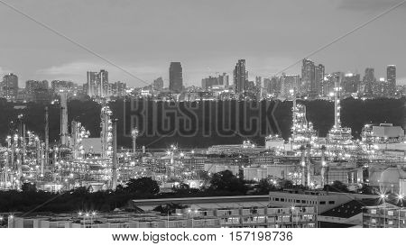 Black and White, Oil refinery with city downtown background