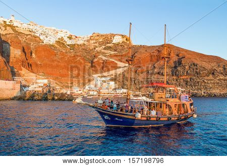 Santorini Greece - October 13 2012: The Oia village with a brigantine in the foreground seen from the Caldera sea area