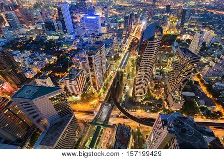 Night aerial view Bangkok city downtown with road intersection, Thailand