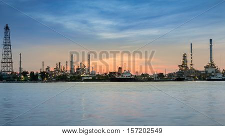 Panorama Oil refinery river front during sunrise