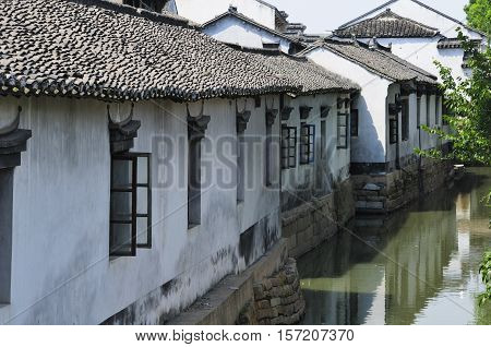 Weathered and old buildings lining the water canals in Luzhi Town in Jiangsu province China