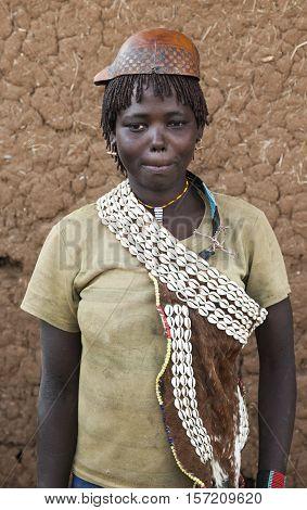 Banna Woman In Calabash Hat/helmet At Village Market. Key Afar. Omo Valley. Ethiopia.
