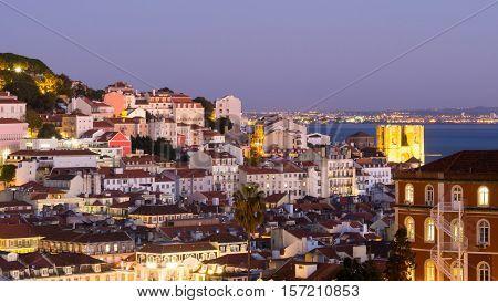 Cityscape of Lisbon Portugal seen from Miradouro Sao Pedro de Alcantara at night