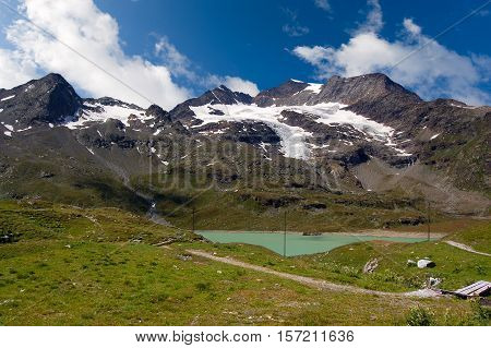 The Bernina Alps with the glacier and the White lake seen from the pass of Bernina (2323 m) Poschiavo Switzerland Europe