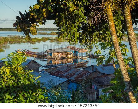 Houses on the flood plain of the Amazon river. Iquitos Peru