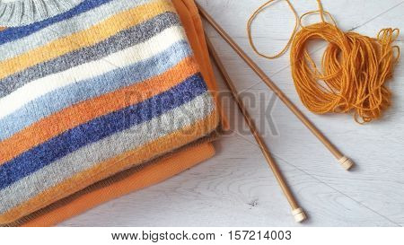 Yarn for knitting and sweaters in grey, ocher and terracotta colors