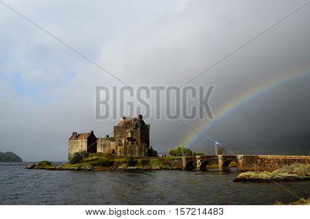 Beautiful Eilean Donan Castle with an arching rainbow.