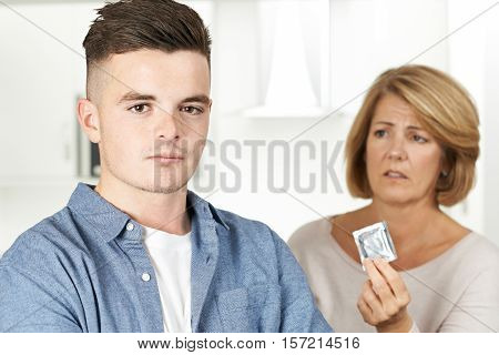 Mother Talking To Teenage Son About Contraception