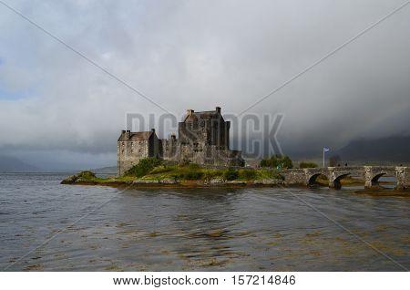Storm clouds over Eilean Donan Castle in Scotland.