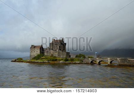Scottish flag flying over Eilean Donan Castle on Loch Duich.