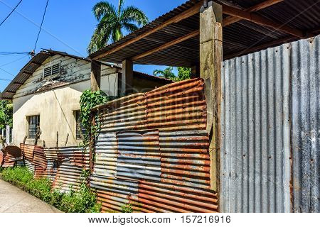 Livingston, Guatemala - August 31 2016: Typical simple house with corrugated iron outbuilding in Caribbean town of Livingston
