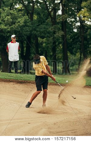 Golfer Playing From Sand Bunker