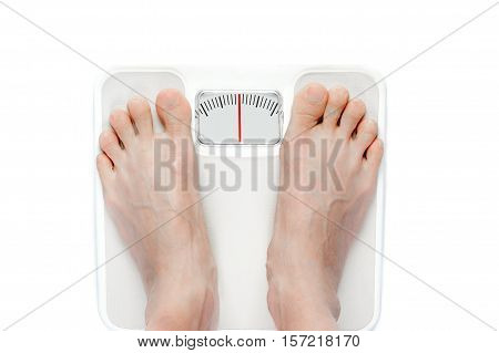 Feet On Mechanical Bathroom Scale Isolated On White