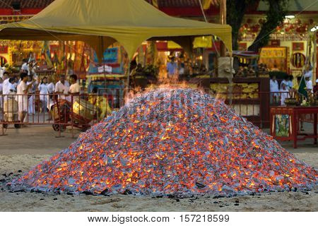 Big ember stack ready to be used for a fire walk during Taoist festival, Phuket, Thailand