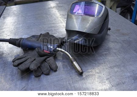 A Couple Of Welder Equipment On A Steel Plate