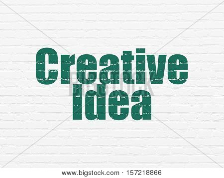 Business concept: Painted green text Creative Idea on White Brick wall background