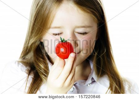Little Girl Showing Small Red Tomato