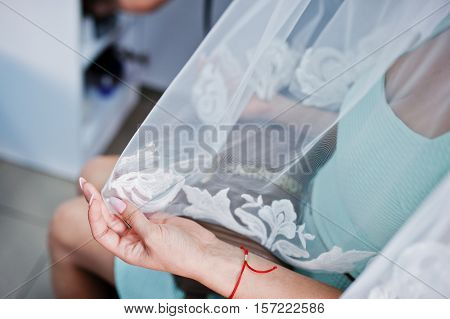 Hand Of Model Bride On Beauty Salon Which Hold A Veil.